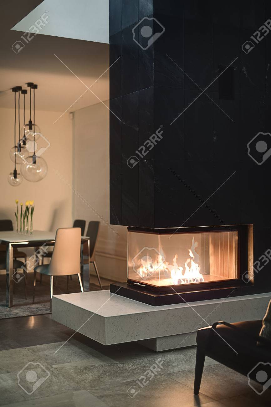 fire black with there inside table is fireplace on glass and chimney background a photo burning the