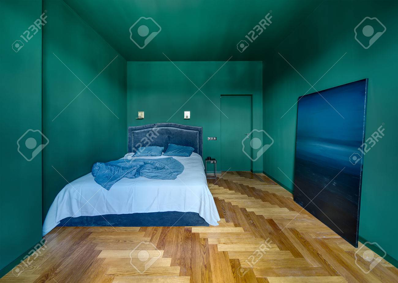 Bedroom In A Modern Style With Turquoise Walls And A Parquet.. Stock ...