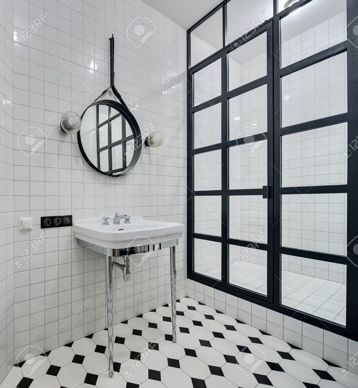 Design Bathroom With Walls Of White Tiles. There Is White Washbasin ...
