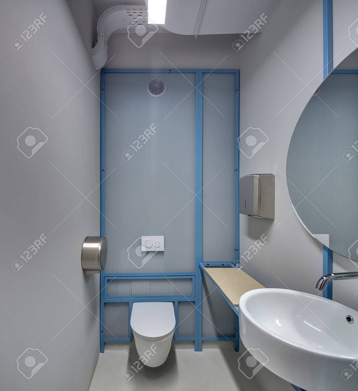 Lavatory In A Loft Style With The Glowing Lamps And Gray Walls ...