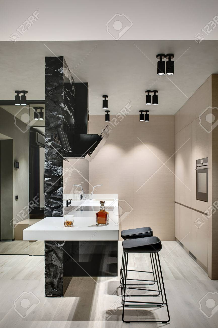 Kitchen Island In A Modern Style With A Black Marble Wall With Stock Photo Picture And Royalty Free Image Image 67008503