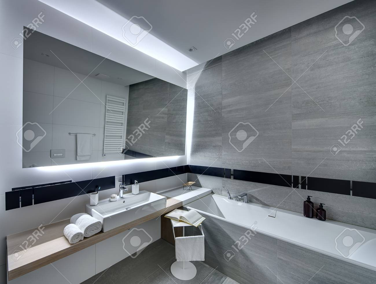 Contemporary Bathroom Tiled With The White And Gray Tiles. There ...