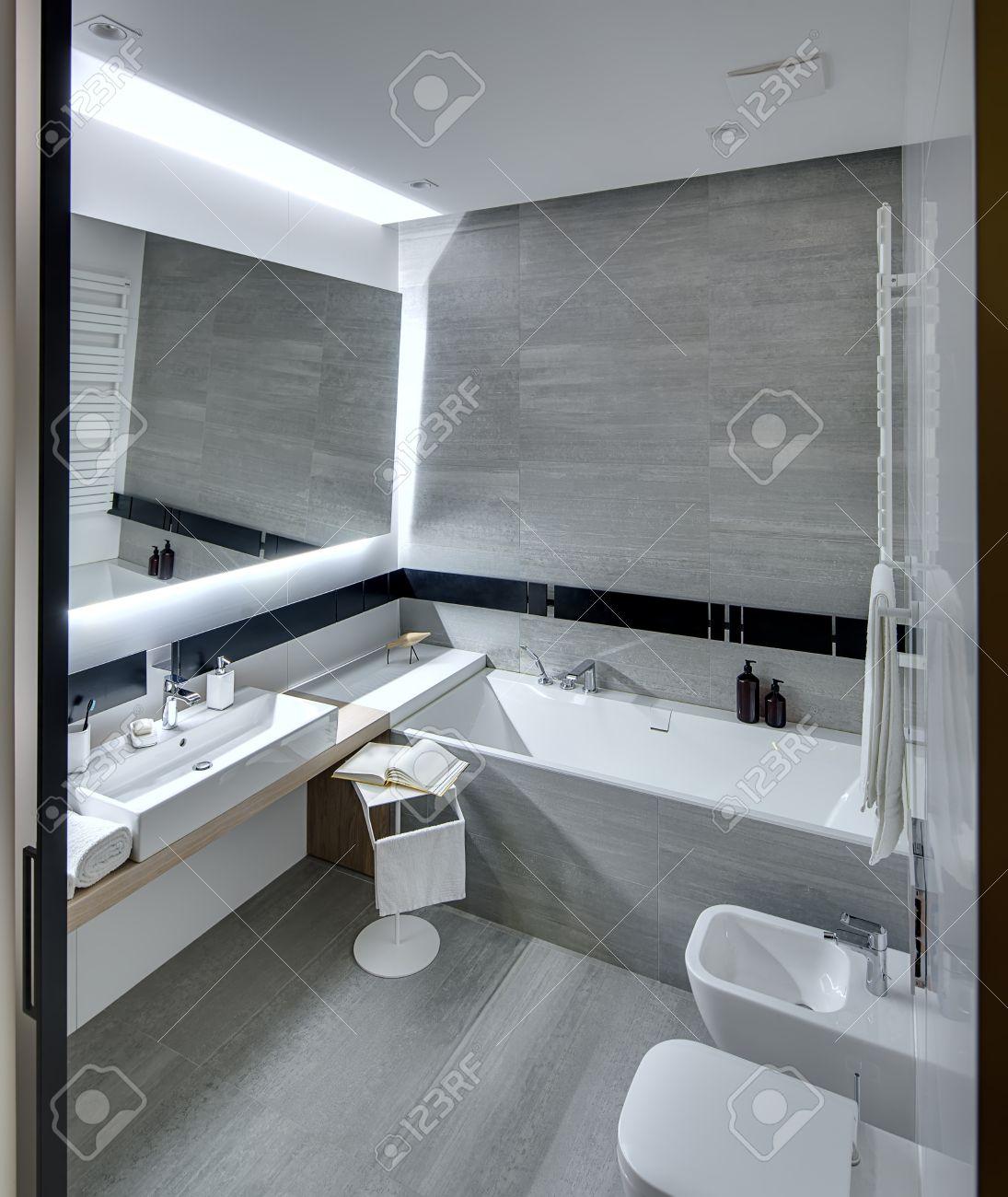 Bad In Einem Modernen Stil Mit Den Weißen Und Grauen Fliesen ...