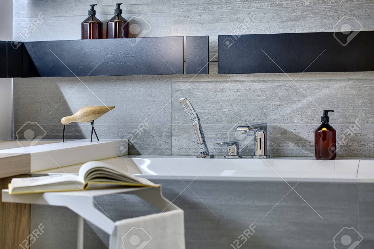 Gray Tiled Bathroom With Black Shelves On The Wall. There Is.. Stock ...