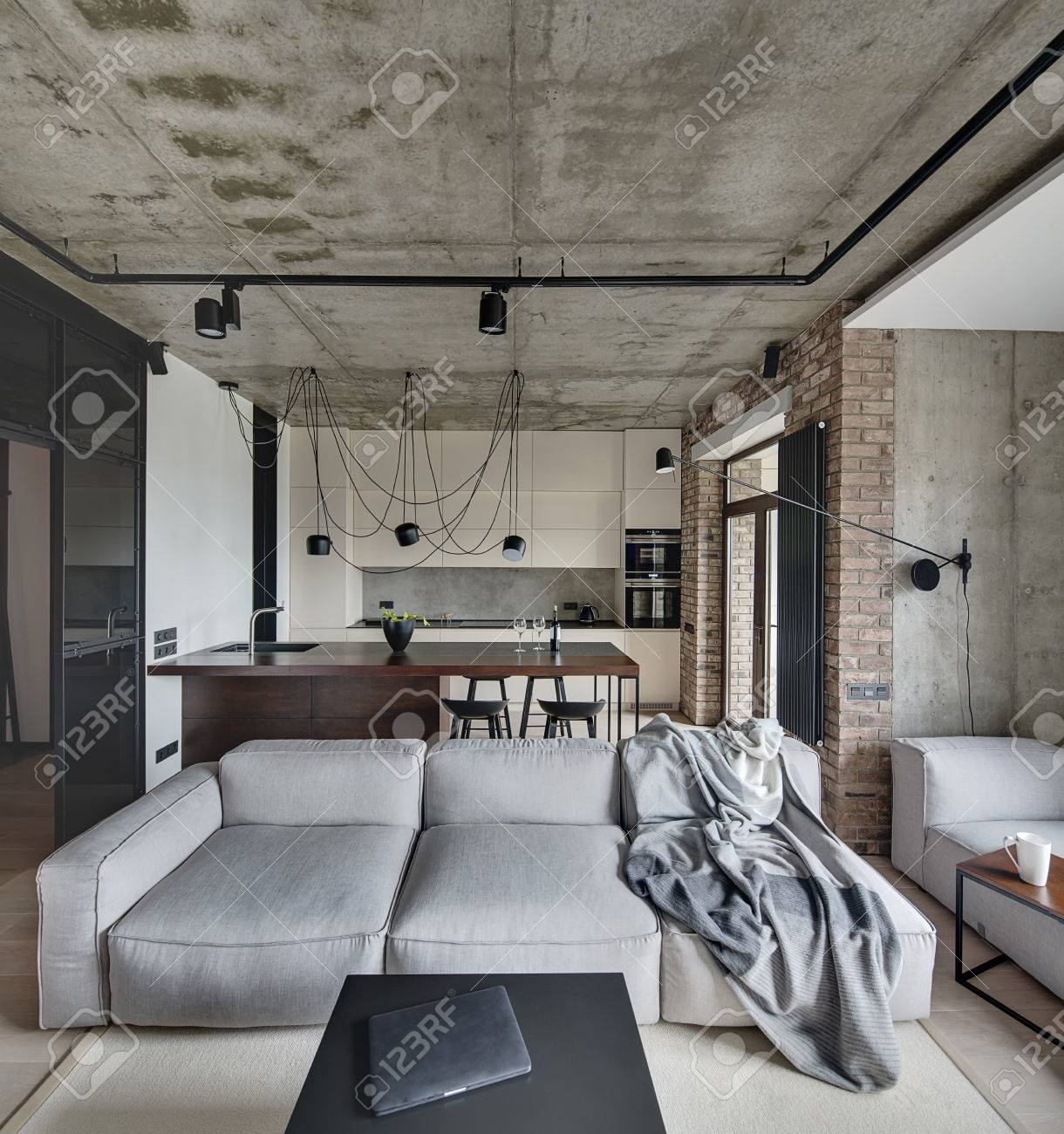 Living Room And A Kitchen Zone In A Loft Style With Concrete And Brick Walls