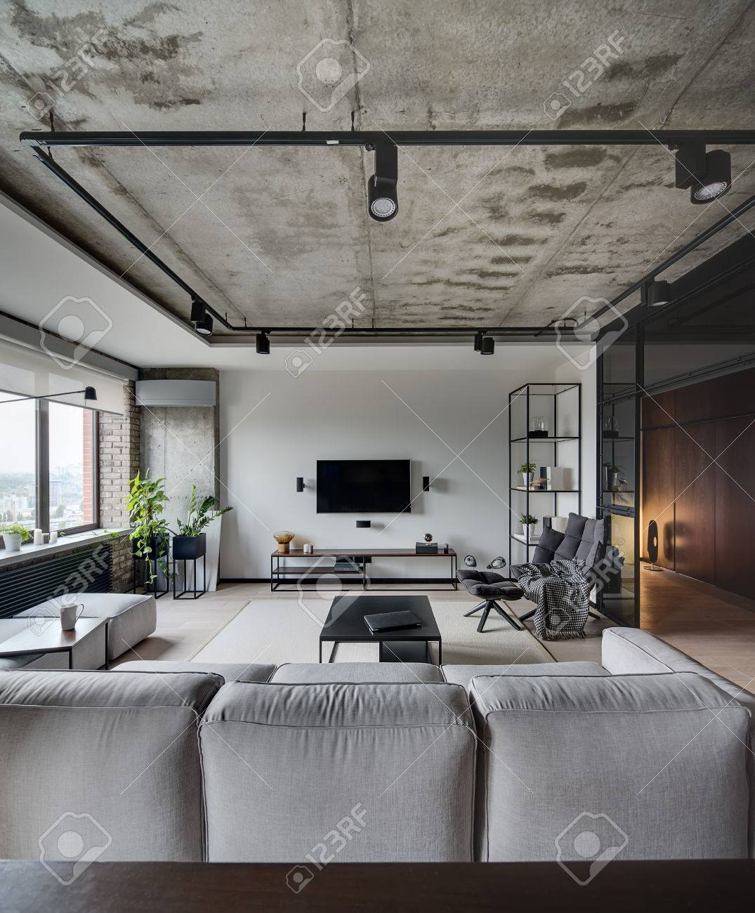 Loft Style Sitting Room With White, Brick And Concrete Walls. There Is Sofa