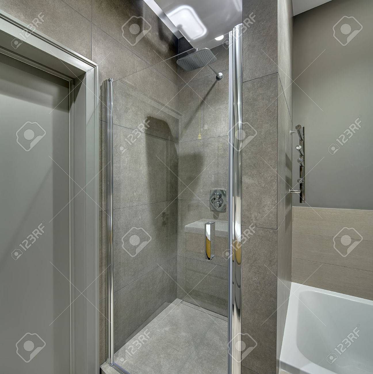 Contemporary Bathroom With Long Tiles On The Walls And Floor ...
