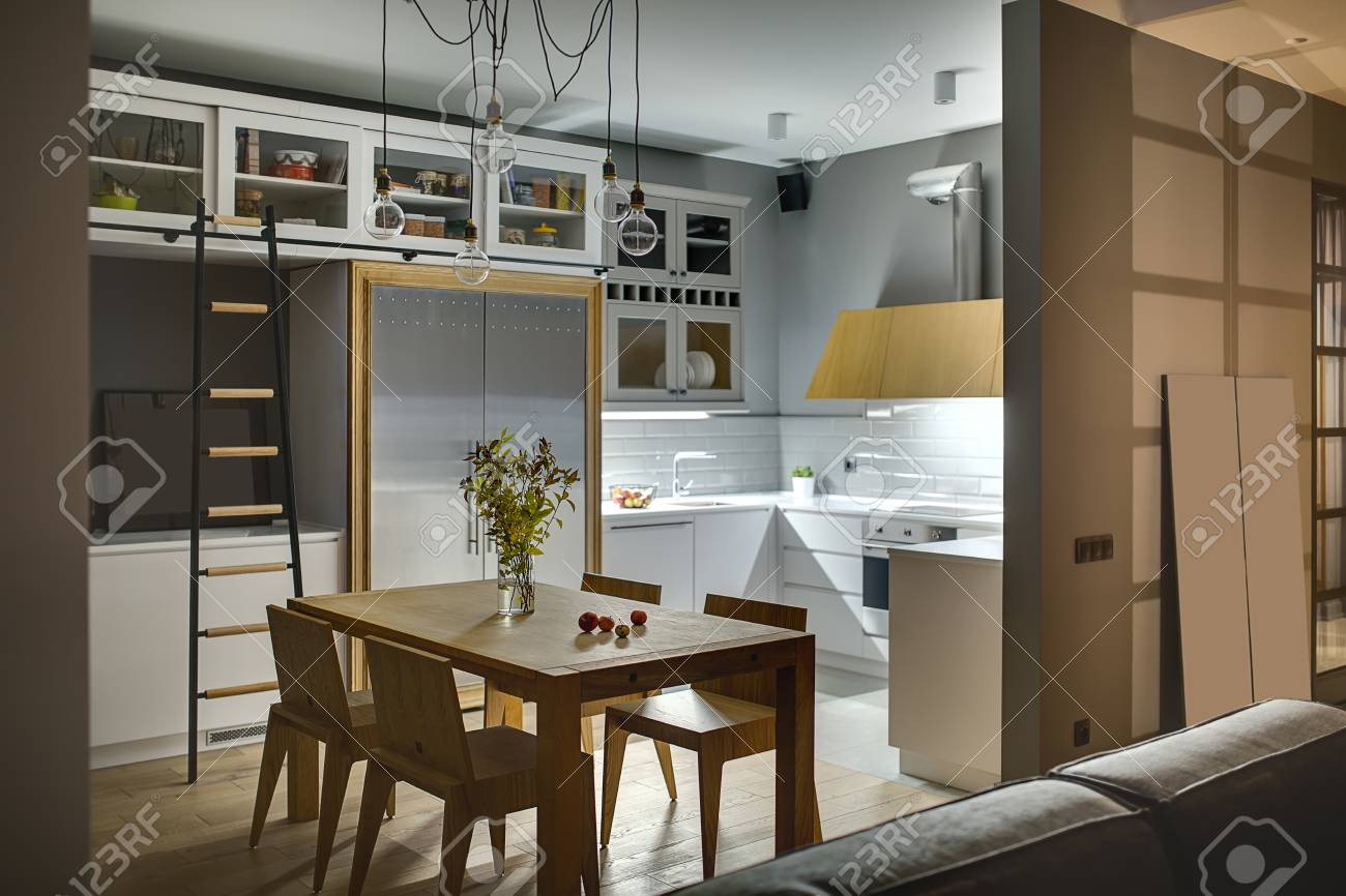 amazing kitchen in a modern style with gray walls white lockers and shelves with accessories amazing kitchen in a modern style with gray walls white lockers      rh   es 123rf com