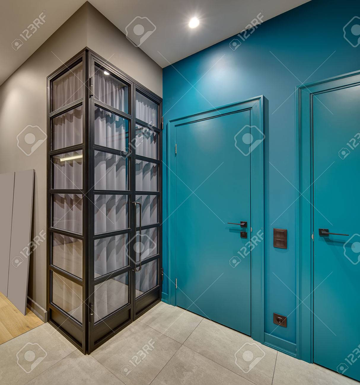 Contemporary Interior With Two Blue Doors On The Same Wall And ...