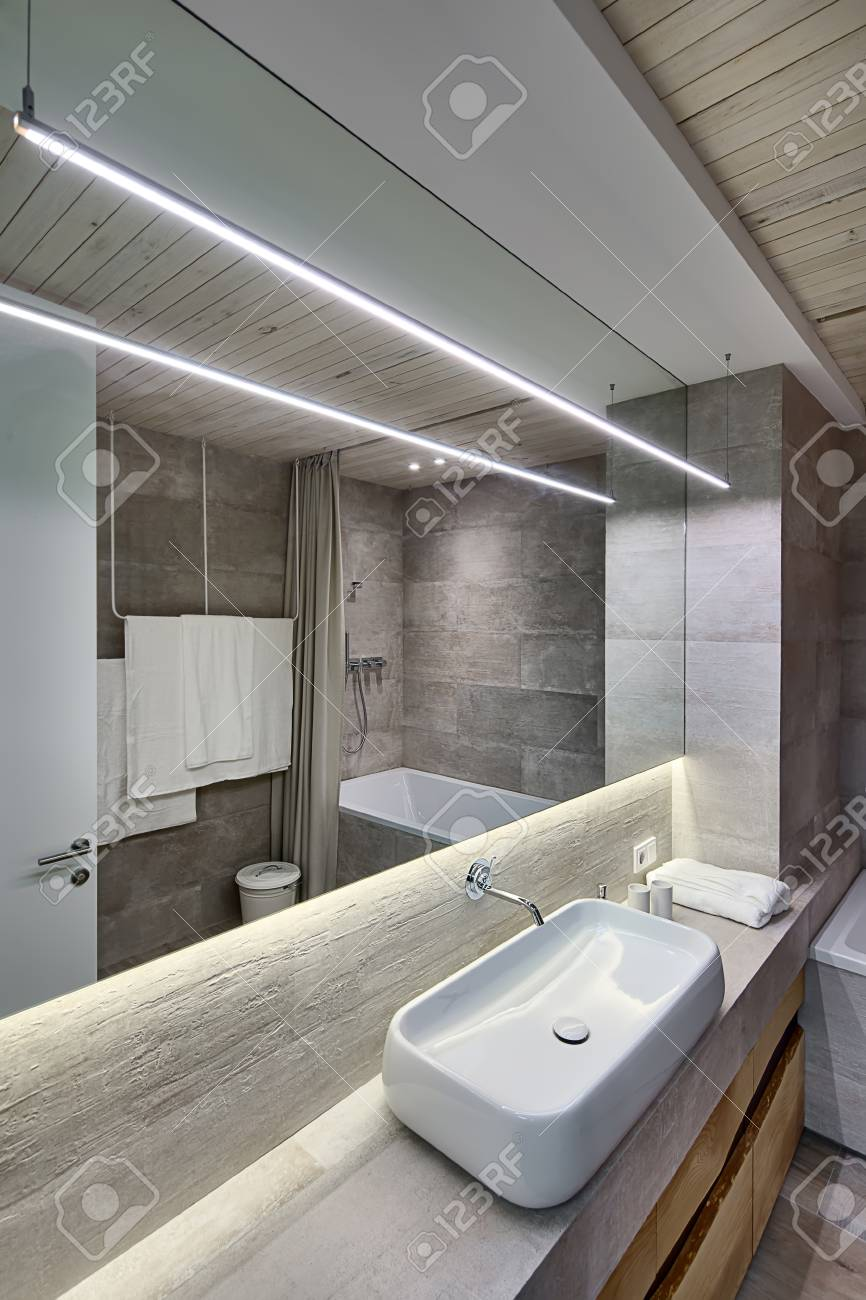 Contemporary Bathroom With Textured Tiles And A Wooden Ceiling