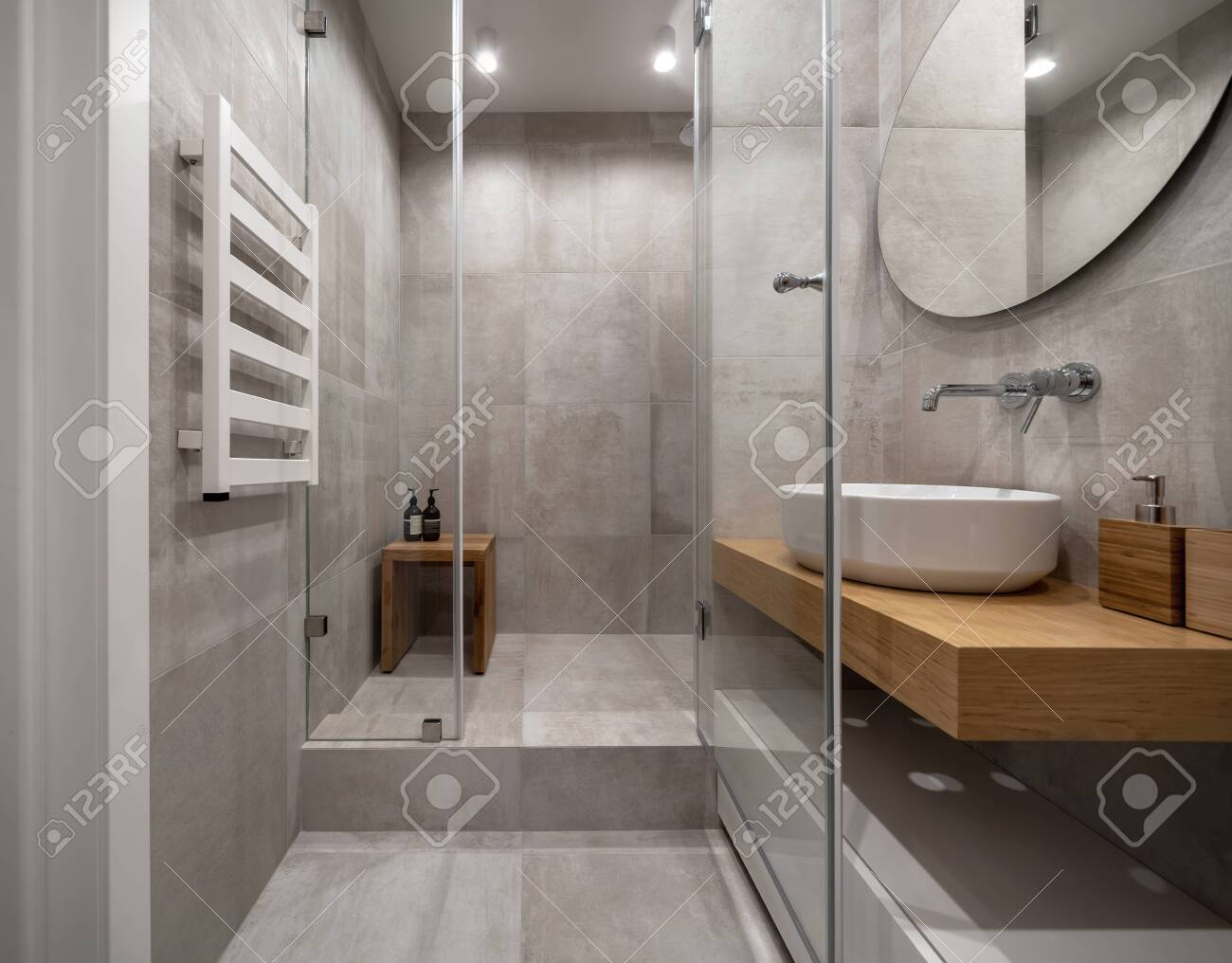 Stylish modern bathroom with light tiled walls and floor - 129141408
