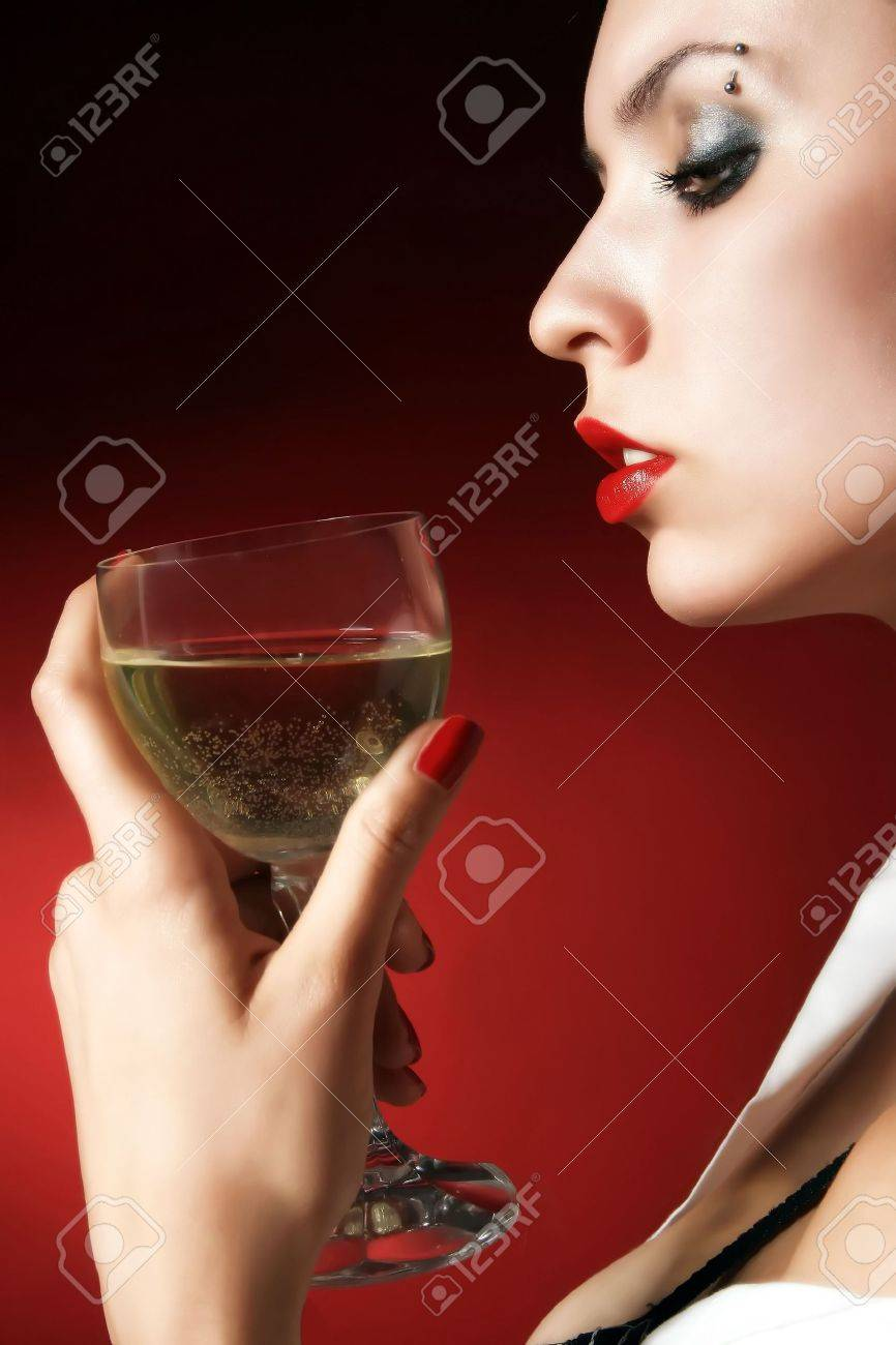 Woman holding a glass of white wine Stock Photo - 2005313