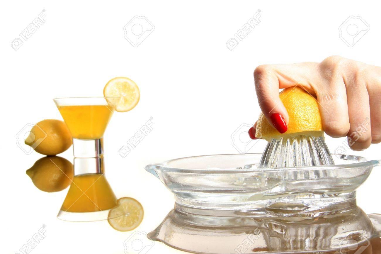Making Lemonade And Squashing Lemon On The White Stock Photo ...