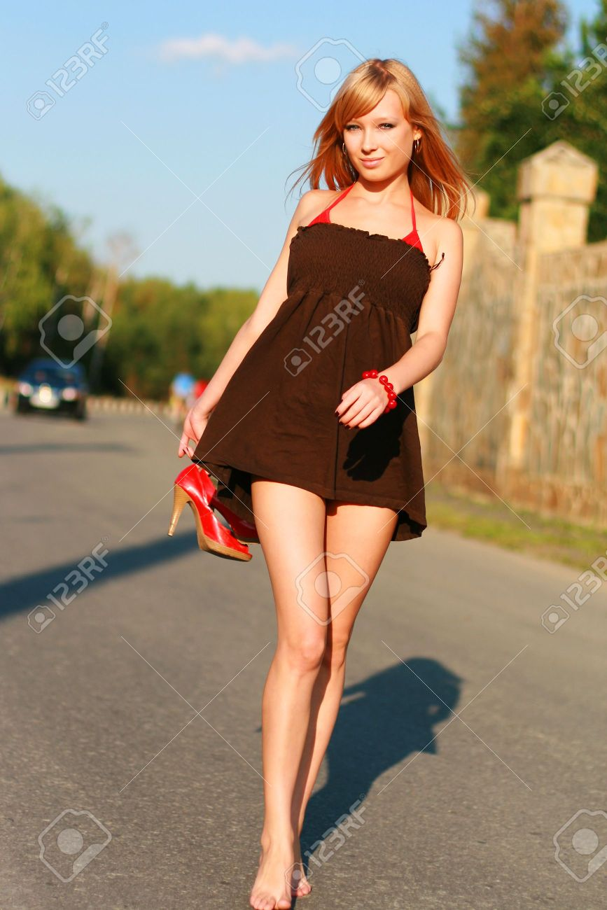 Stock Photo - Young beautiful girl in short dress on road f08b54551