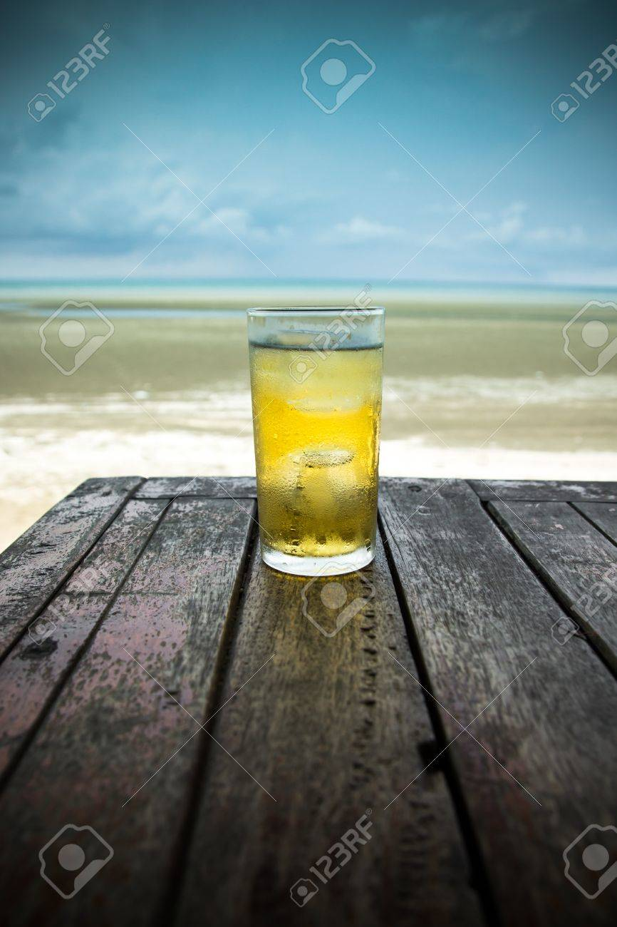 Cold beer on wood table in front the sea of Thailand - 18936496