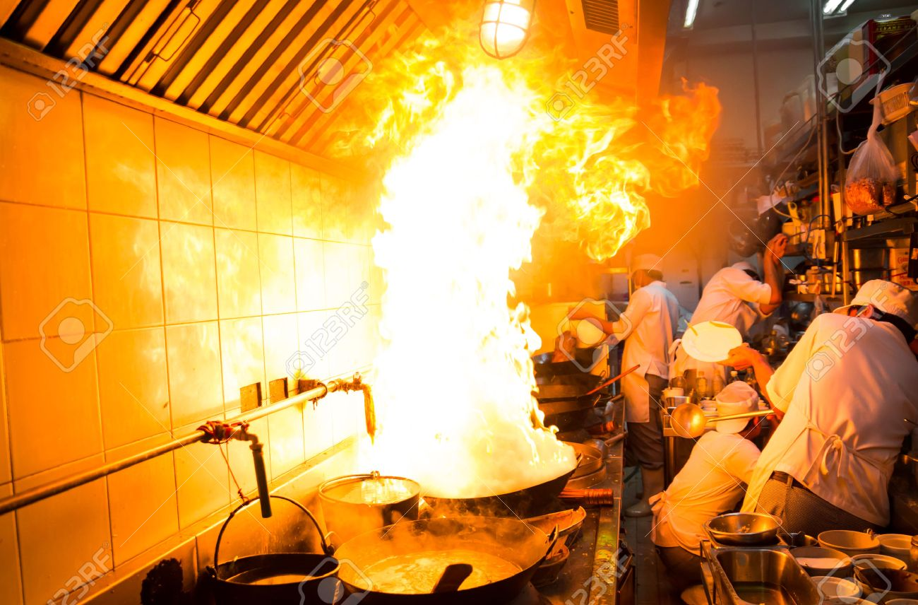 Fire gas burn is cooking on iron pan,stir fire very hot - 22256757