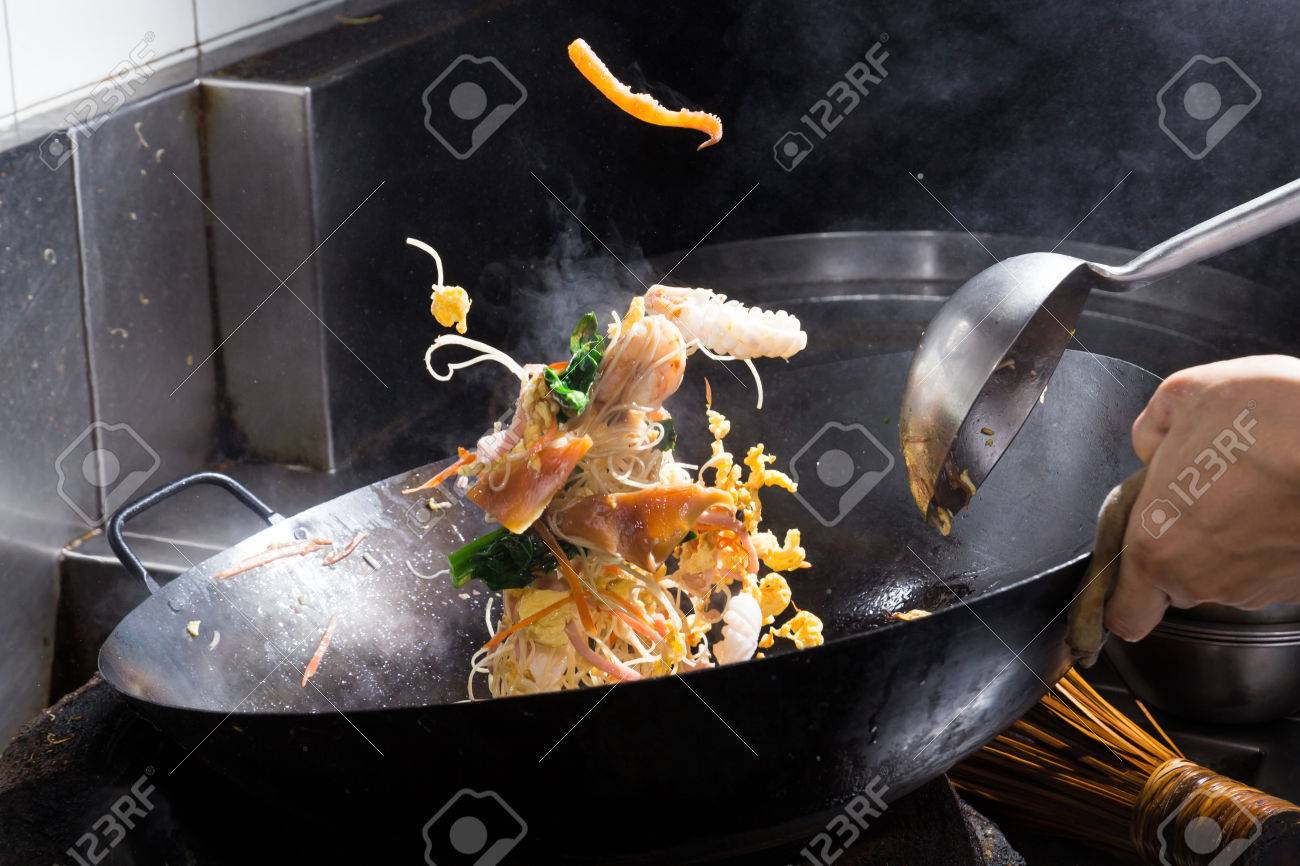 Stir fire cooking on iron pan,motion cooking,stop action - 25592840