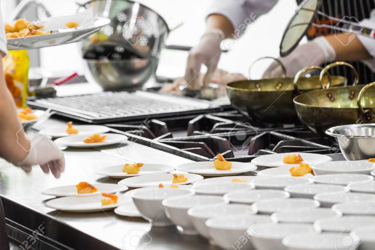 Busy Restaurant Kitchen busy cooking of chefs in restaurant kitchen stock photo, picture