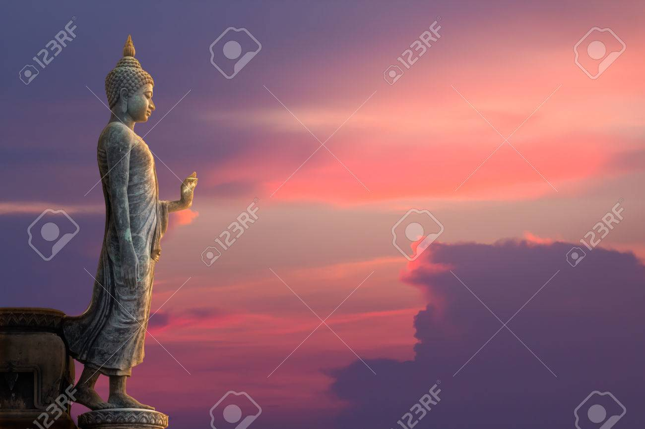 Big Buddha statue on sunset sky - 27970154