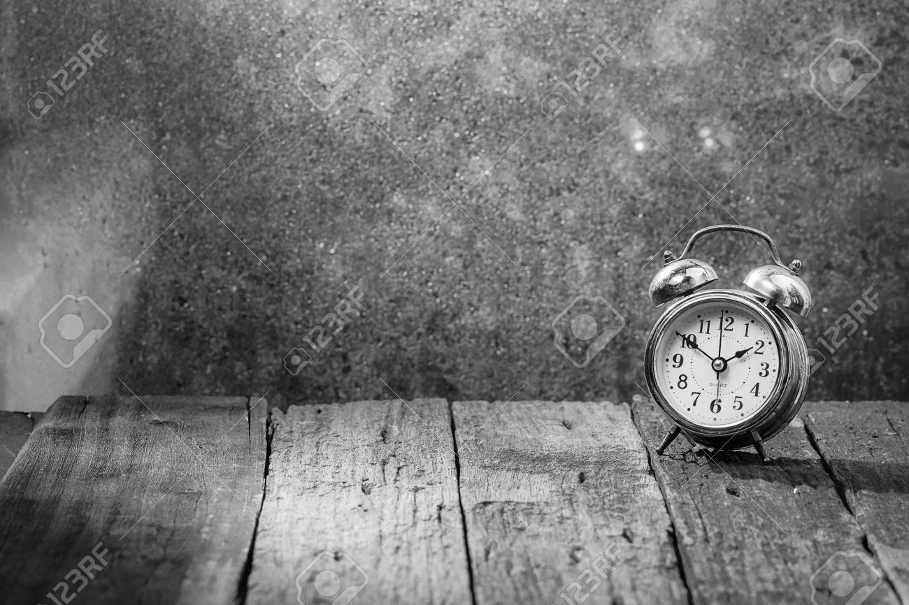 Vintage Background With Retro Alarm Clock On Tableblack And White Stock Photo