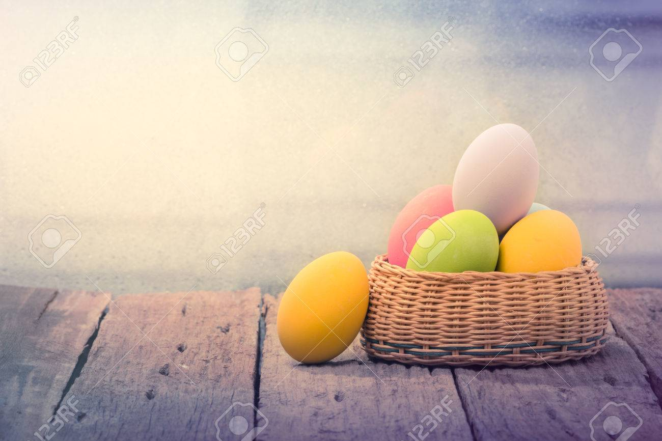 Easter eggs in the nest on rustic wooden background - 34283949