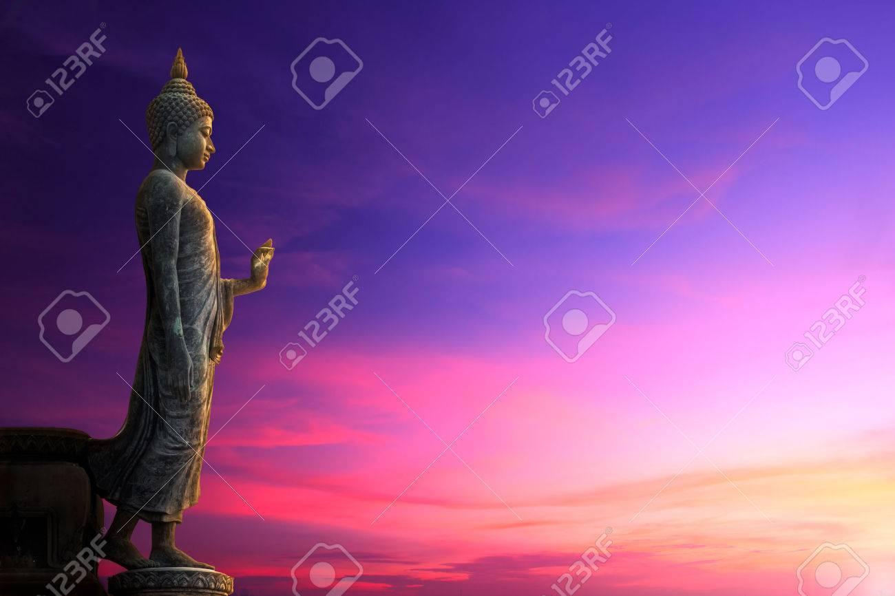 Big Buddha statue on sunrise sky - 34556316
