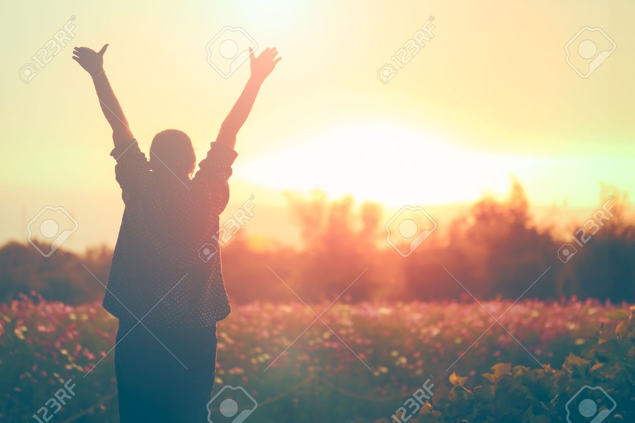 cheering woman open arms at sunrise flowers garden,Nature of Life - 57952007