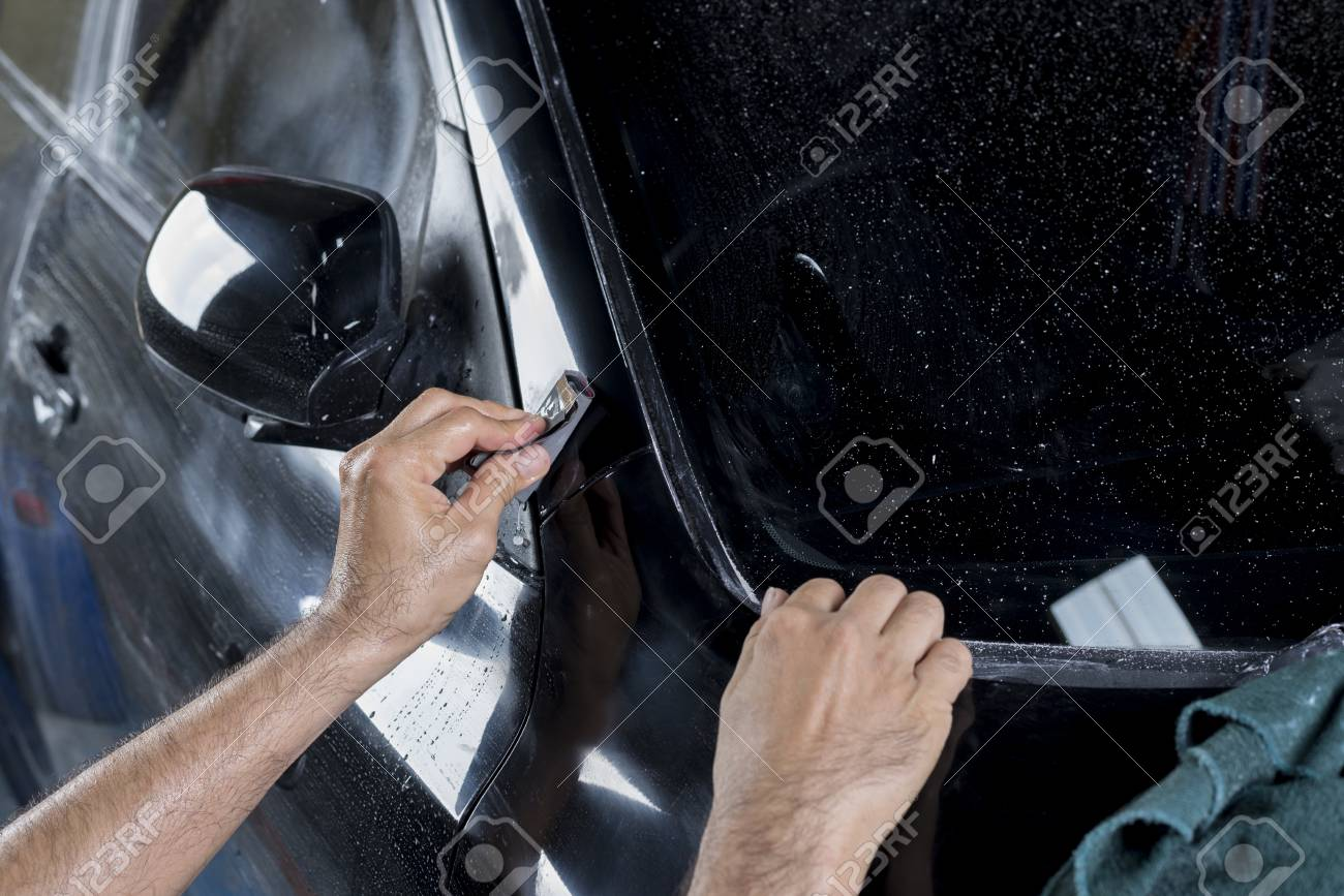 Auto Body Repair Series Closeup Of Hand Wet Sanding Car Paint