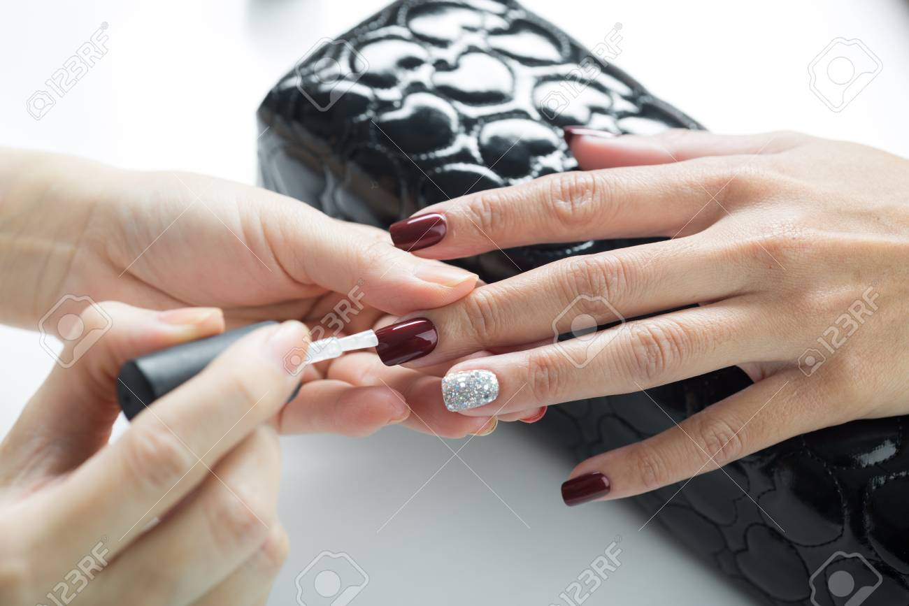 Manicure And Pedicure Series Manicurist Applying Clear Nail Stock