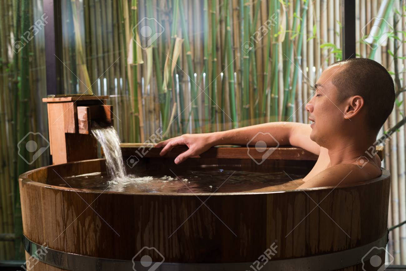 Onsen Series Asian Man Taking A Bath In Wooden Bathtub Stock Photo Picture And Royalty Free Image Image 87726531