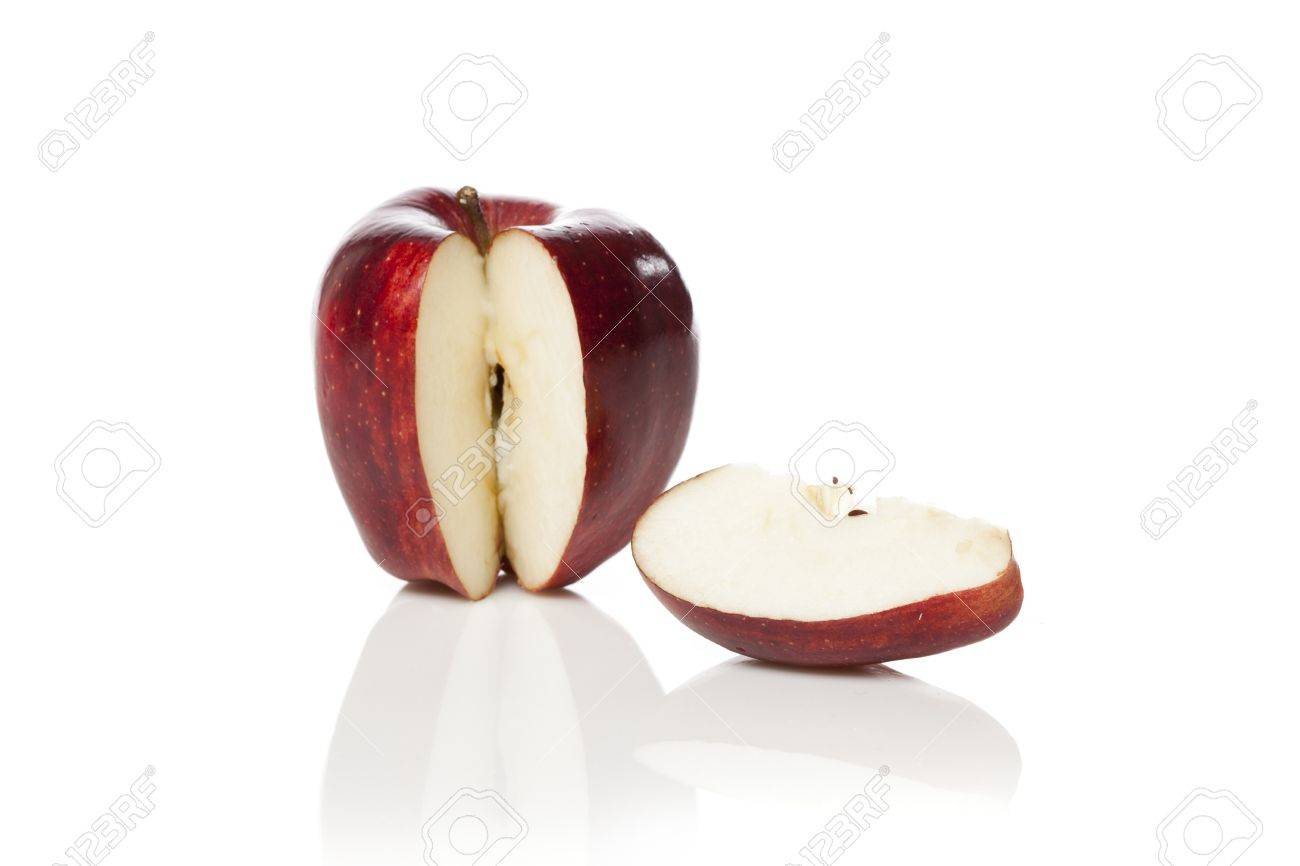 red apple slice. a fresh red apple with slice cut out on white background stock photo -