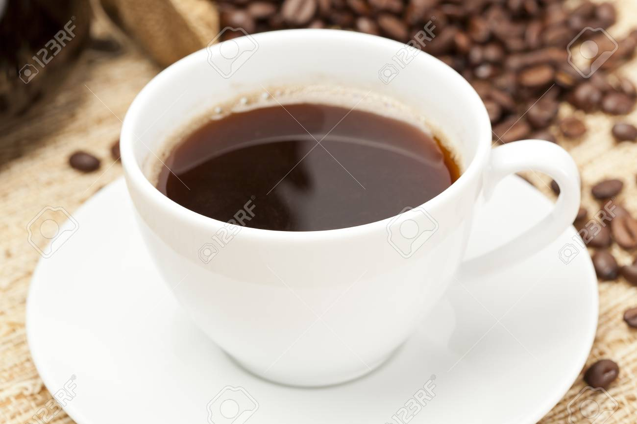 Black Coffee with coffee beans on a background Stock Photo - 14228860