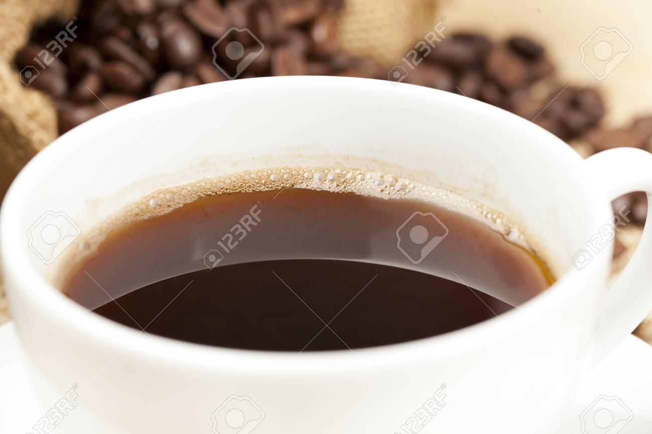 Black Coffee with coffee beans on a background Stock Photo - 14228862