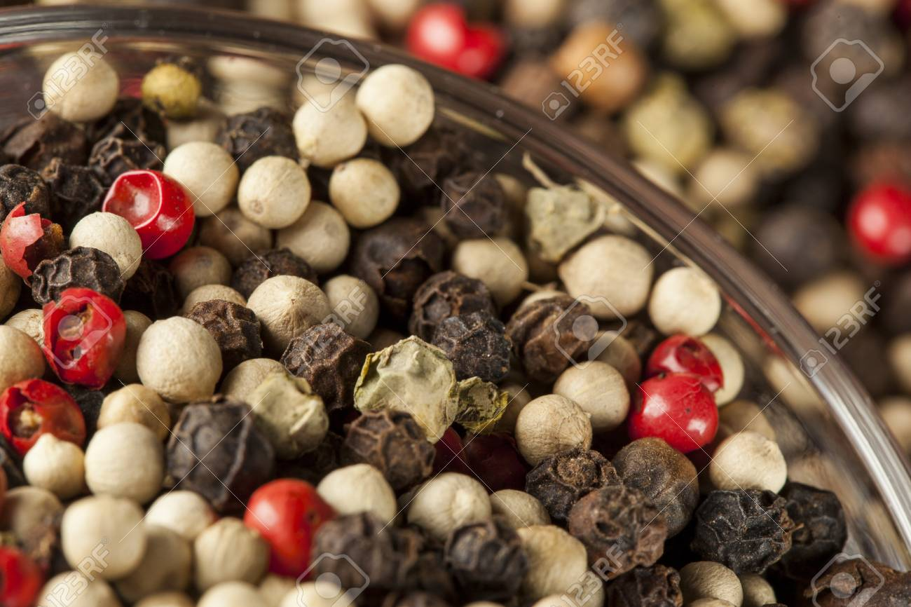 Raw Whole Four Peppercorn Blend against a background Stock Photo - 18583171