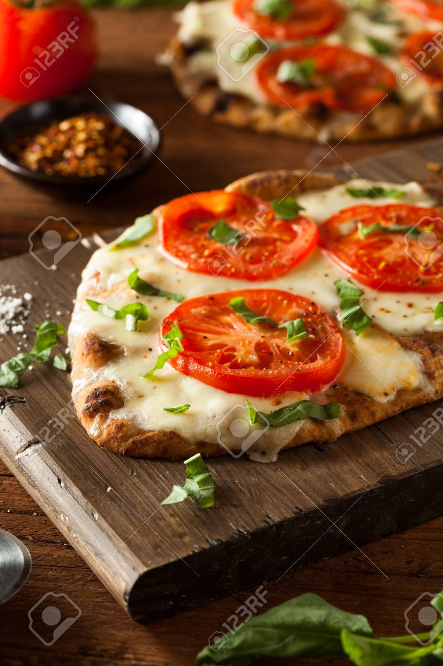 Homemade Margarita Flatbread Pizza With Tomato And Basil Stock Photo