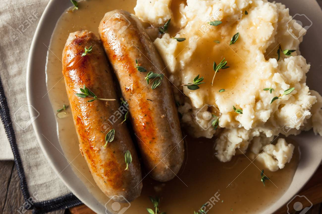 Selbst Gemachte Bangers And Mash Mit Kräutern Und Gravy ...