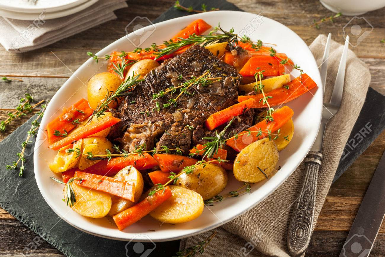 Homemade Slow Cooker Pot Roast with Carrots and Potatoes - 53875202