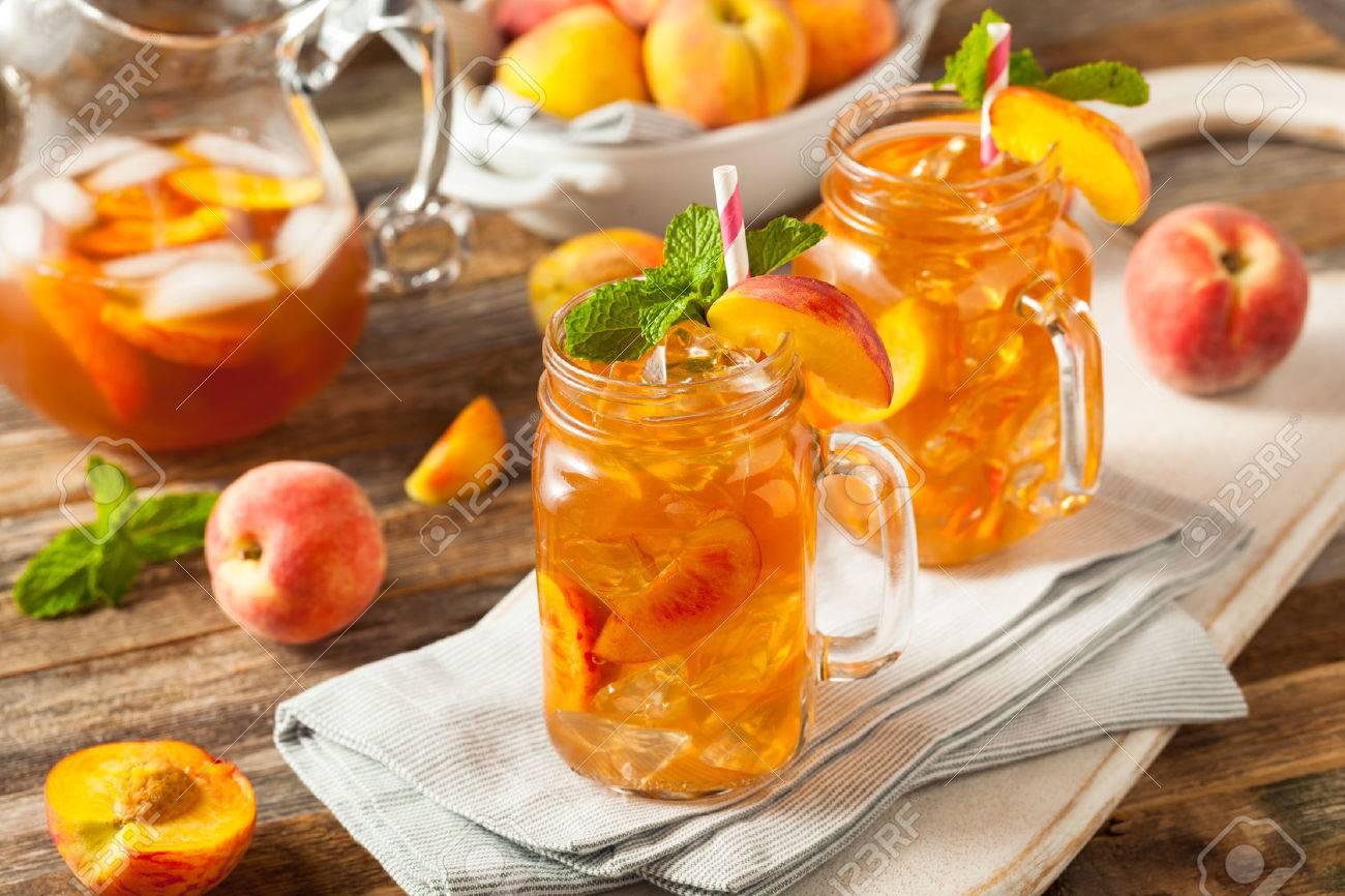 Fresh Homemade Peach Sweet Tea with Mint - 56251628