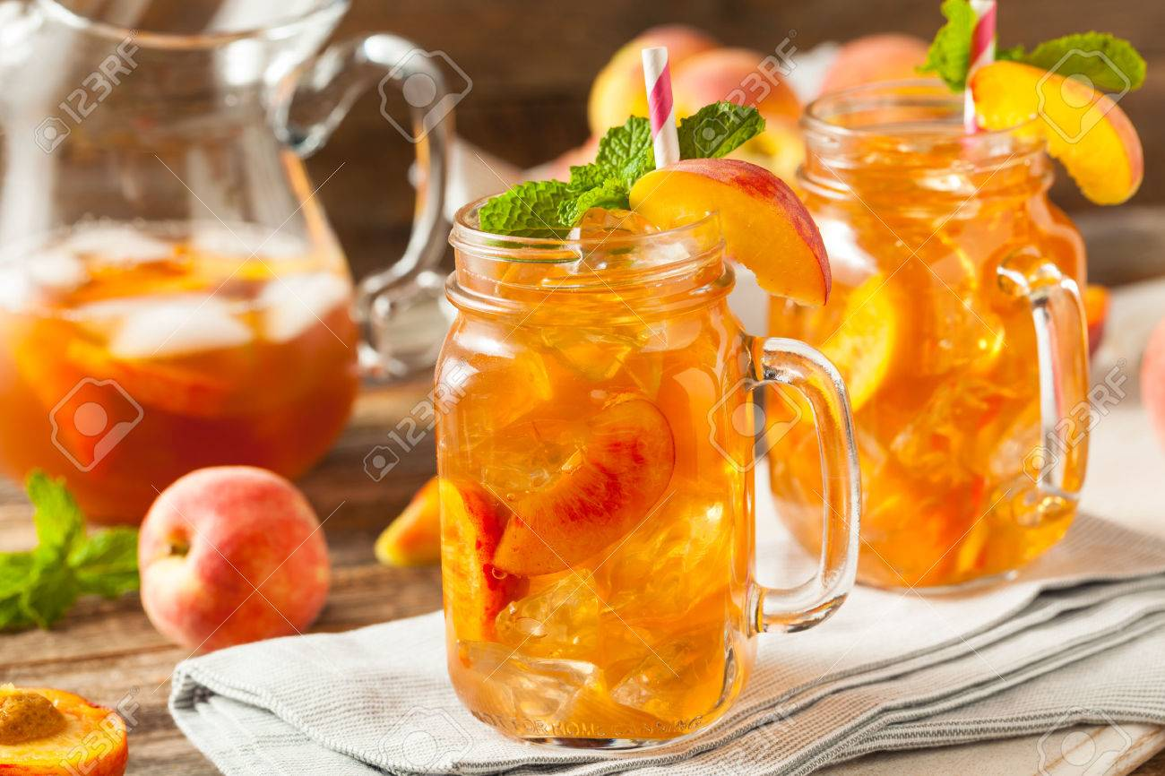fresh homemade peach sweet tea with mint stock photo picture and