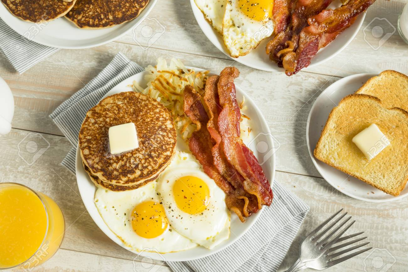 Healthy Full American Breakfast with Eggs Bacon and Pancakes - 84828903