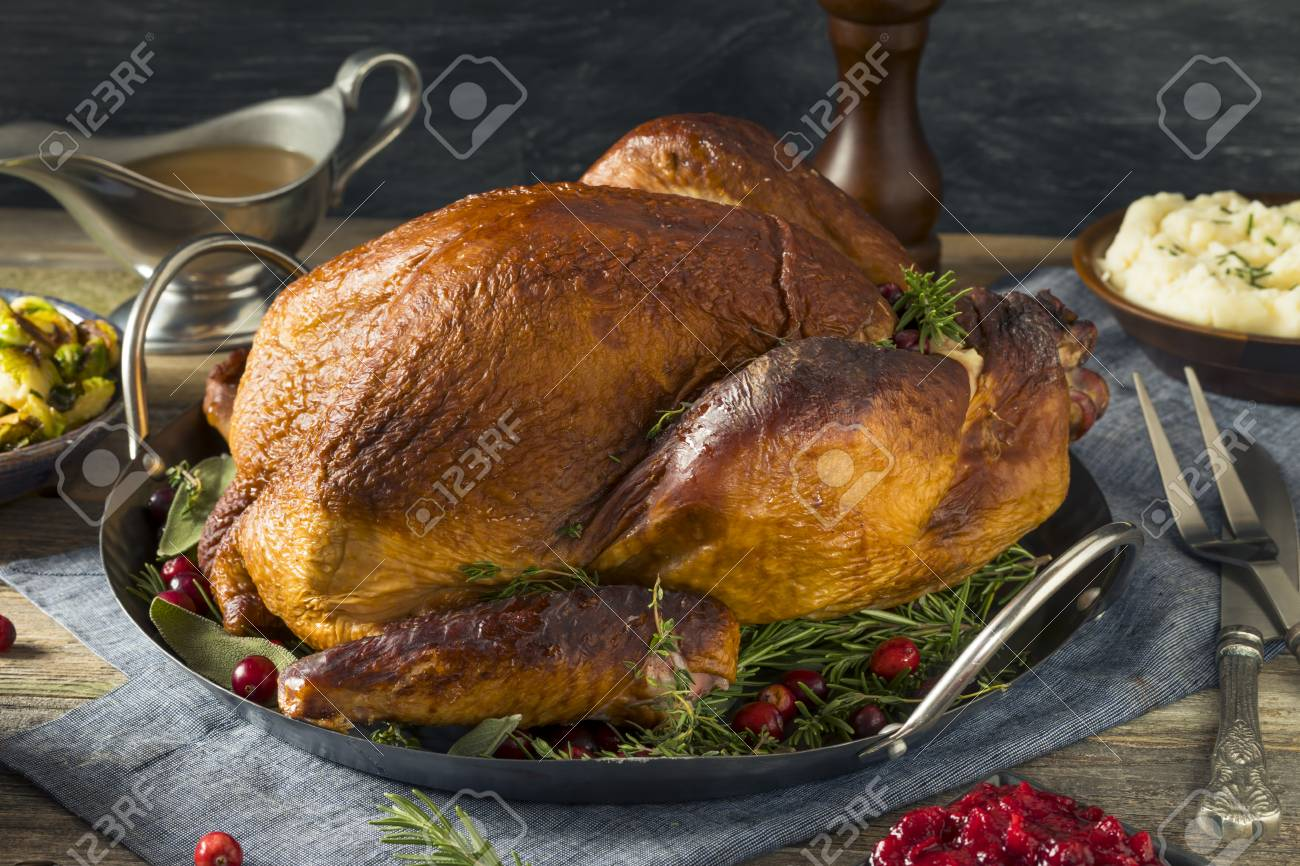 Organic Homemade Smoked Turkey Dinner For Thanksgiving With Sides Stock Photo 88606776