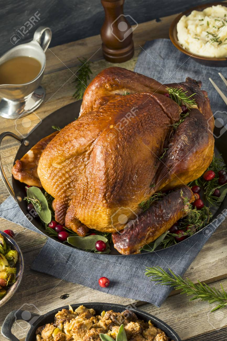 Organic Homemade Smoked Turkey Dinner For Thanksgiving With Sides Stock Photo 88606784