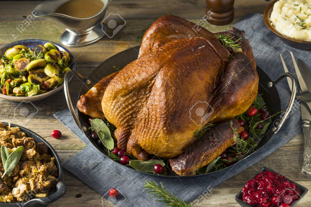 Organic Homemade Smoked Turkey Dinner For Thanksgiving With Sides Stock Photo 88607989