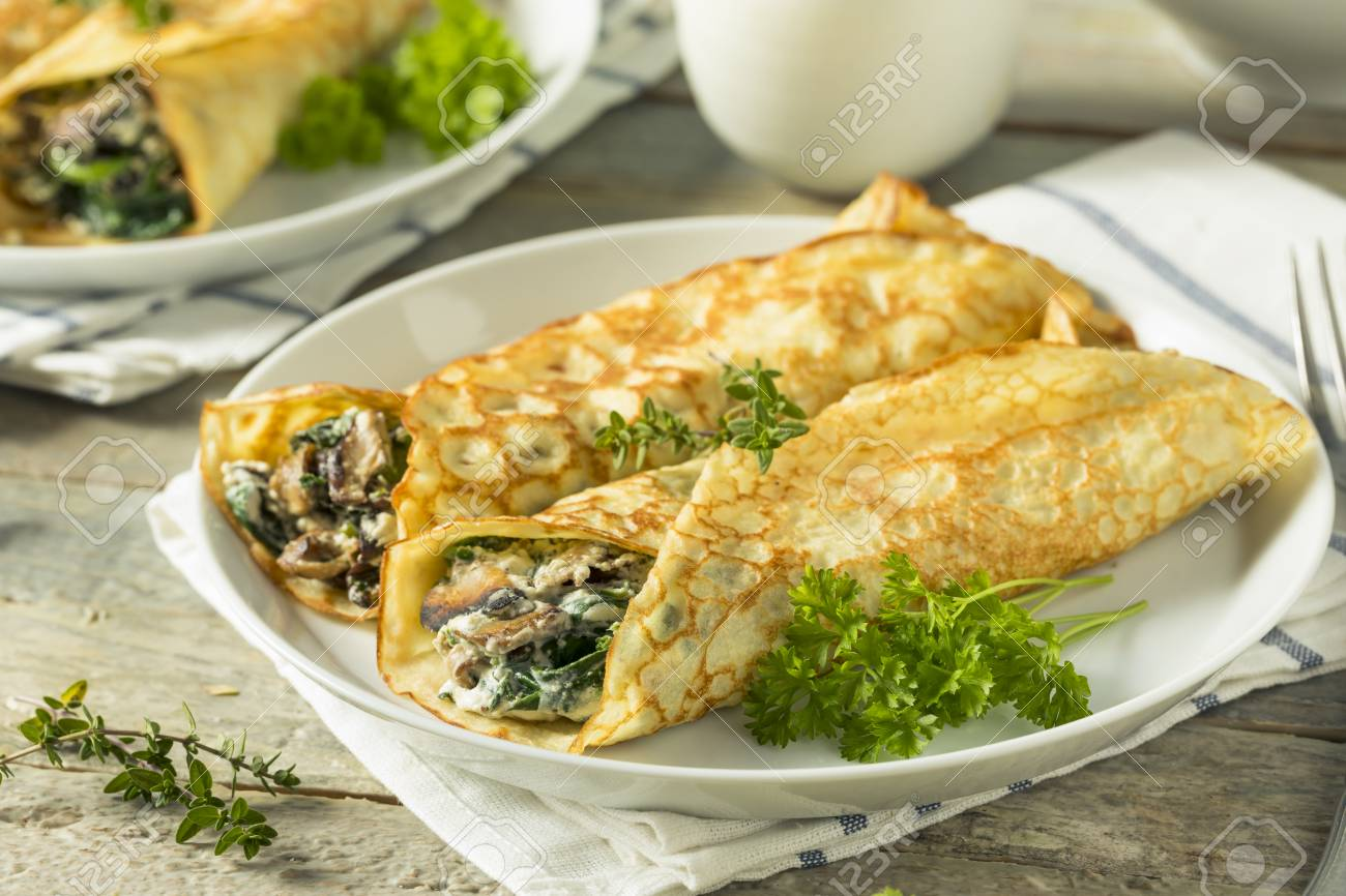 Savory Homemade Mushroom and Spinach Crepes with Cheese - 89491221