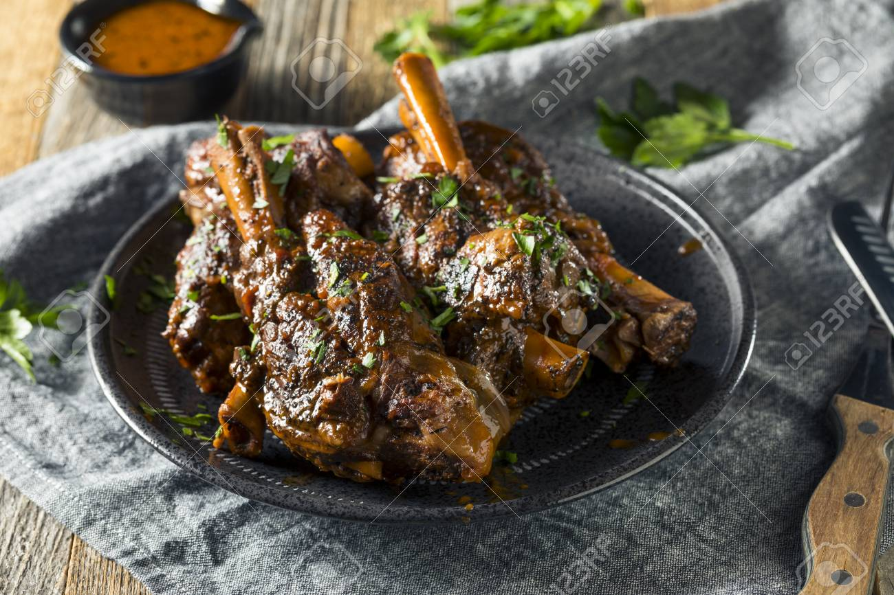 Homemade Braised Lamb Shanks with Sauce and Herbs - 95844062