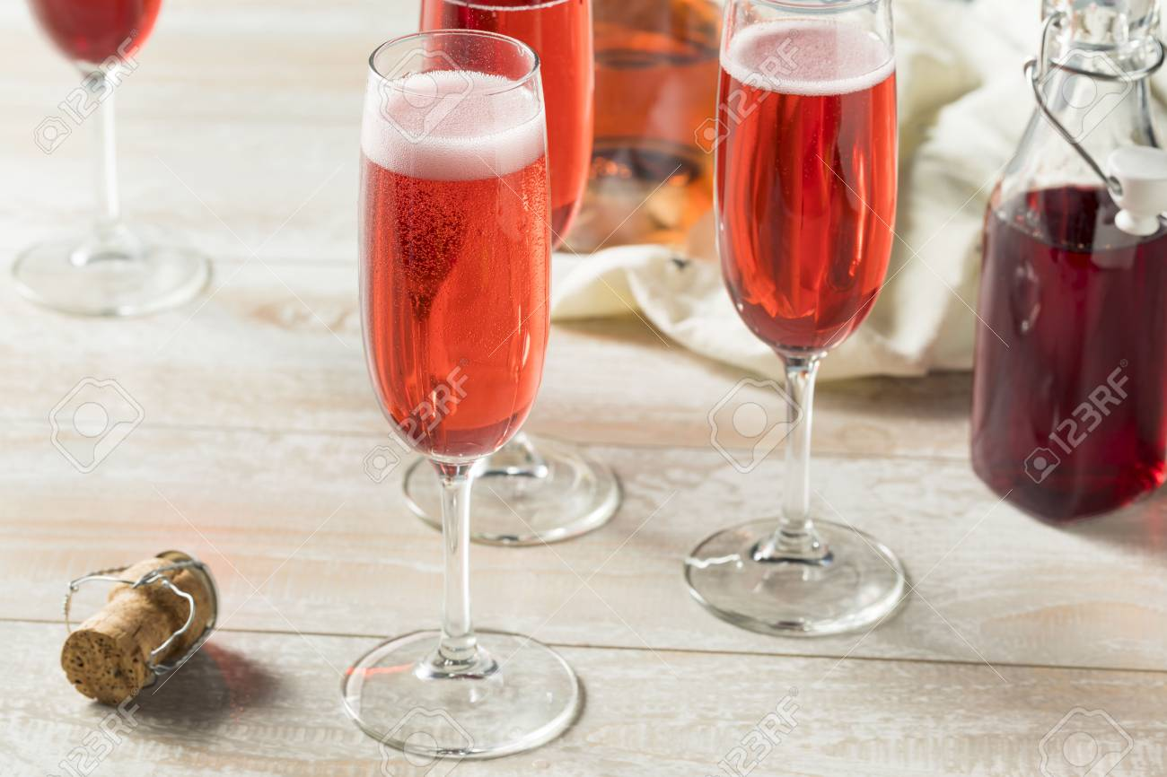 Sweet homemade Rose Mimosas with Berry Syrup - 101578110
