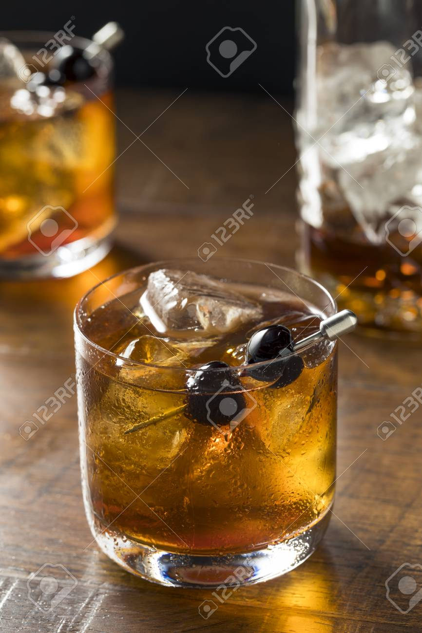 Boozy Manhattan Cocktail On The Rocks With A Cherry Garnish Stock Photo Picture And Royalty Free Image Image 101905408