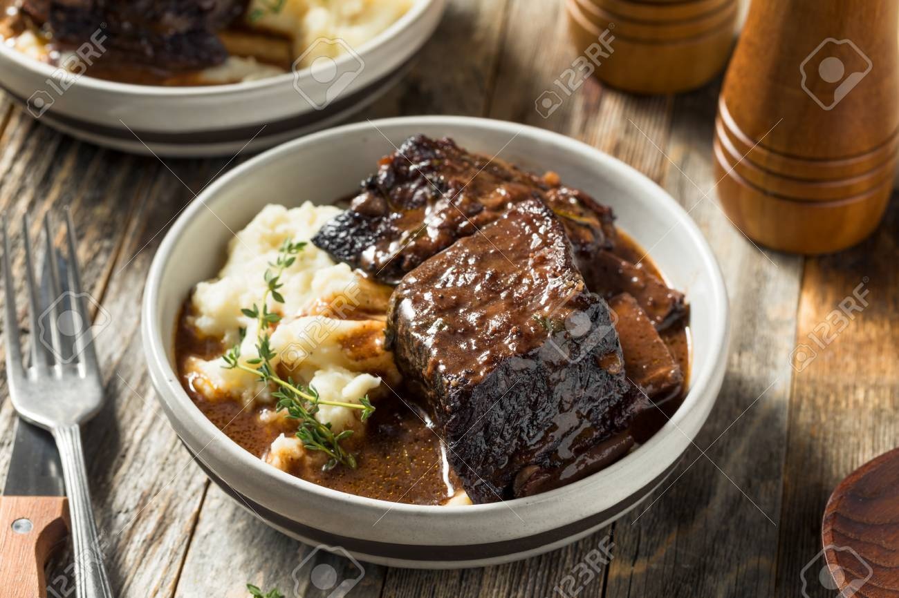 Homemade Braised Beef Short Ribs with Gravy and Potatoes - 121882867