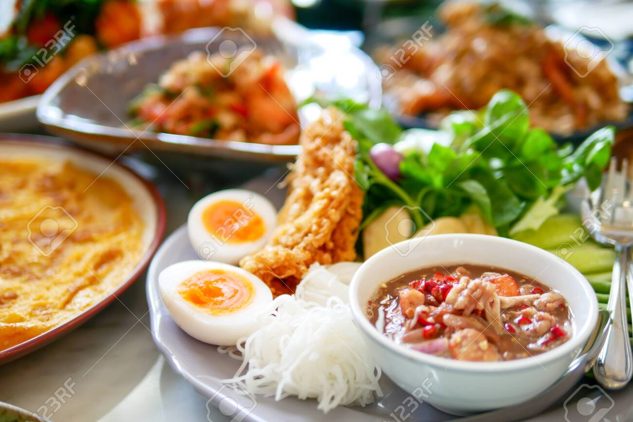 Southern of Thai food that delicious and spicy with variety of menu that placed on the marble table, top view - 130316151