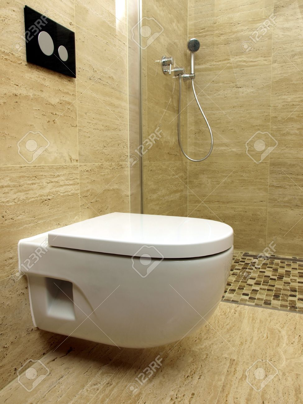 Wall Mounted Toilet In A Modern Bathroom With Travertine Tiles ...